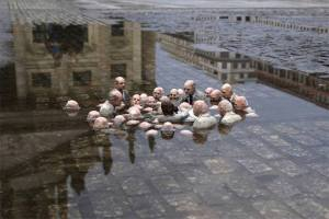 """Follow the leaders."" Sculpture by Issac Cordal highlighting the risks in global warming."