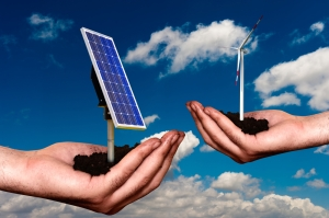 hands-holding-wind-turbine-and-solar-panel